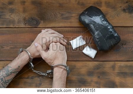Drug Trafficker Arrested With Their Heroin Packages. Police Arrest Drug Dealer With Handcuffs And Na