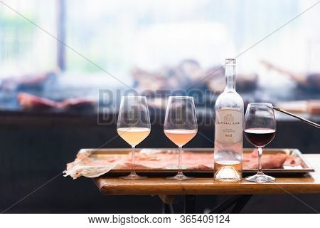 Tuscany. Italy. Summer 2019. Orange And White Wine In Glasses. Cooking Meat And Drinking Wine. Wine