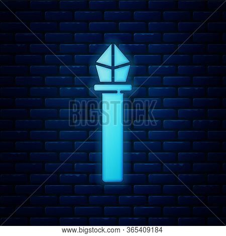 Glowing Neon Magic Staff Icon Isolated On Brick Wall Background. Magic Wand, Scepter, Stick, Rod. Ve