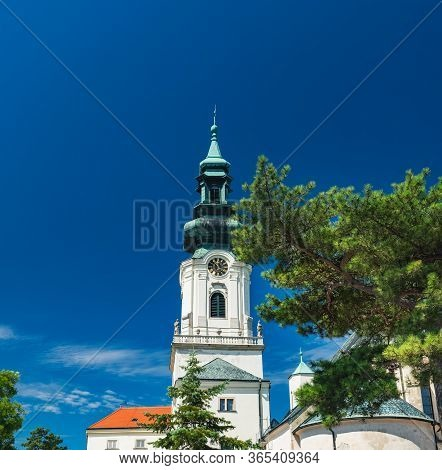 Nitra Castle Located In Old Town Of Nitra, Slovakia. Main Entrance, Tower Of Castle With Clock Under