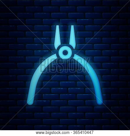 Glowing Neon Pliers Tool Icon Isolated On Brick Wall Background. Pliers Work Industry Mechanical Plu