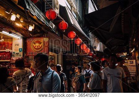 Jiufen, Taiwan - November 07, 2018: People Walk Along The Crowded Old Street Market On November 7, 2