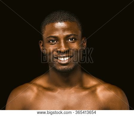 Positive Nude African American Man Toothy Smiles Looking At Camera. Portrait Of Sexy Dark-skinned Ma