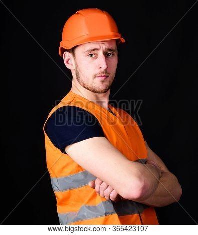 Strong Builder Concept. Builder In Helmet Posing Confidently. Man In Helmet, Hard Hat Hold Arms Cros