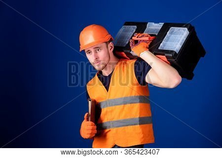 Man In Helmet, Hard Hat Holds Toolbox And Folder With Documents, Blue Background. Repair Service Con