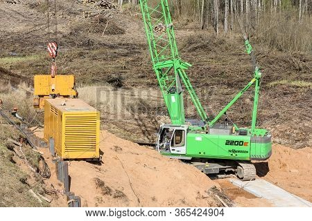 Kirishi, Russia - 8 May, Crane With Cargo On The Hook, 8 May, 2020. Start Of Construction Of A Motor