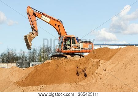 Kirishi, Russia - 8 May, The Driver Controls The Operation Of The Excavator, 8 May, 2020. Start Of C
