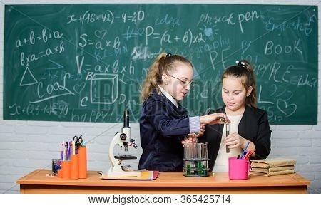 Expect Something Extra. Girls Genius In School Lab. Science Lab. Little Girls Scientist With Microsc
