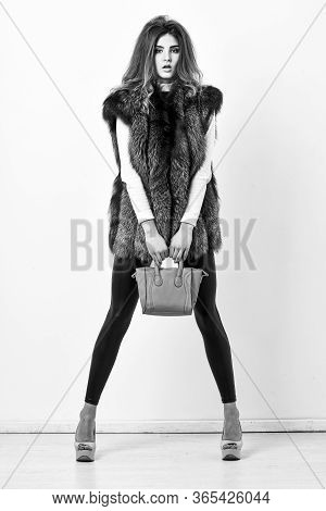 Fashion And Shopping Concept. Woman In Fur Coat With Handbag On White Background. Female Fashion Mod