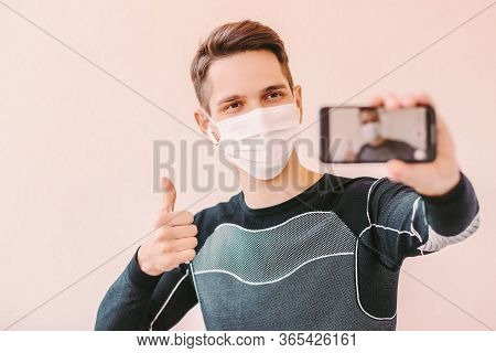 Confident Sports Man In Protective Medical Face Mask Showing Thumb Up Like For Workout Training At H