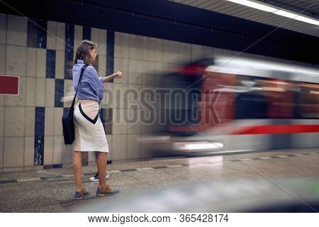 Business woman waiting for metro in subway.Young woman waiting for a train in metro.