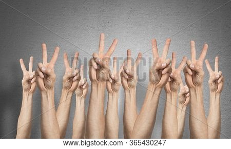 Row Of Man Hands Showing Victory Gesture. Winning Or Triumph Group Of Signs. Human Hands Gesturing O