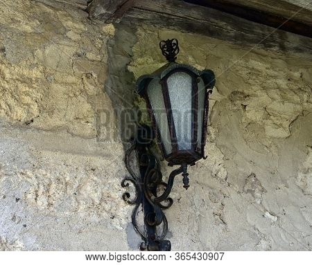 Antique Black Lantern Made Of Metal And Glass In Rural Part Of The Country