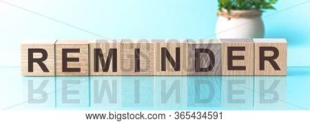 Reminder Word Written On Wood Block. Reminder Text On Wooden Table For Your Desing, Concept.