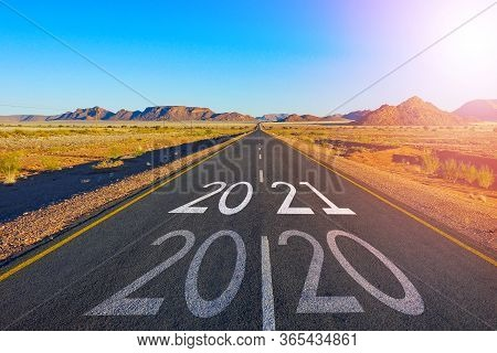 Concept For New Year 2021.the Word 2020 Written On American Highway Road In The Middle Of Empty Asph