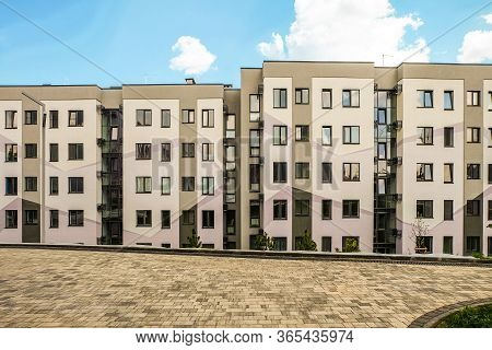 Belgorod, Russia - July 29, 2019: Facade Residential Typical Building Under A Blue Cloudy Sky And Fo