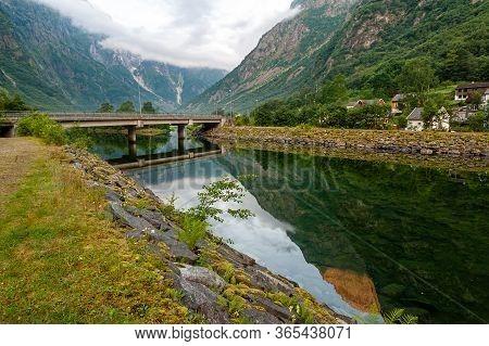 Beautiful Idyllic Mountain Landscape. Gudvangen Is A Popular Tourist Village Located At The Very Beg