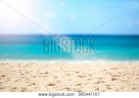 Blurred Summer Background, Nature Of Tropical Golden Beach With Rays Of Sun Light. Golden Sand Beach