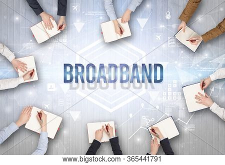 Group of Busy People Working in an Office with BROADBAND inscription, modern technology concept