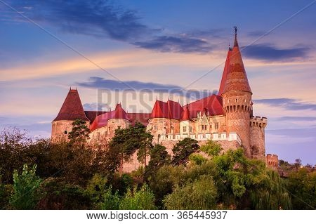 Legendary Corvins Castle In Hunedoara At Dawn. One Of The Largest In Europe And Is In A List Of Seve