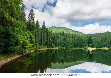 Scenery With Forest Reflecting In The Lake. Synevyr National Park Is A Popular Destination Of Ukrain