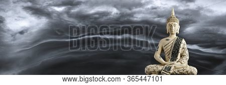 A Small Replica Statue Of The Buddha Against A Smokey Background