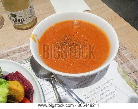 Wien, Austria - Circa September 2018: Tomato Soup Bowl And Vegan Vegetable Side Dish