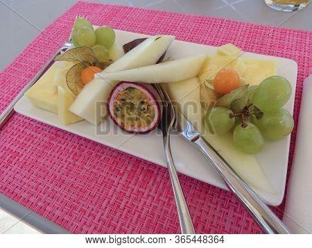 Cagliari, Italy - Circa October 2019: Fruit Salad In A White Rectangular Dish