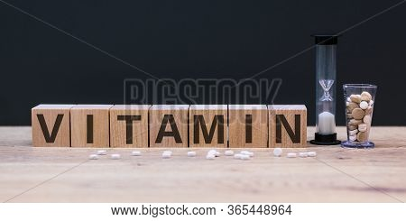 Vitamin Word From Cubes On Background. Vitamins A B C D E, Healthy And Medical Concept.