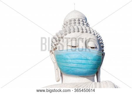 Close Up Of Big Buddha Head With Surgical Mask Isolated On White Background. Buddhism And Meditation