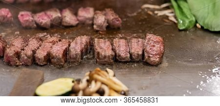 Kobe Beef Steak Or High Quality Steak On Hot Plate Pan During Teppanyaki Japanese Chef Cooking And G