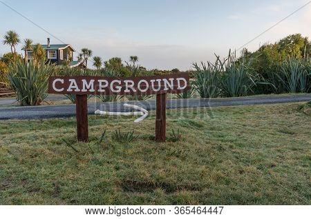 Okarito, New Zealand - July 29, 2015: Sign To Okarito Campground In Countryside New Zealand, Tourist