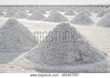Sea Salt Pile Pyramid Made From Evaporation Of Seawater And Ready For Harvest In Salt Farm At Sunset