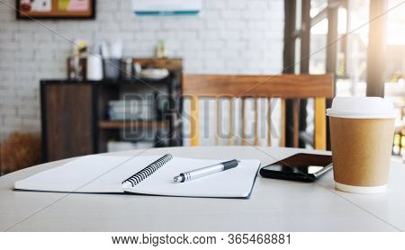 Place Of Work On Desk At Home, Close Up Of Pen On Notebook With Smartphone And Coffee Cup, Concept W