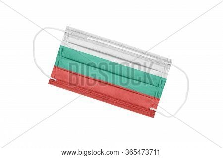 Medical Mask With The Flag Of Bulgaria On A White Background. The Concept Of A Pandemic In Bulgaria.