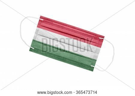 Medical Mask With The Flag Of Hungary On A White Background. The Concept Of The Pandemic In Hungary.