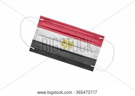 Medical Mask With Flag Of Egypt Isolated On White Background. The Concept Of The Pandemic In Egypt.