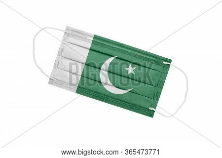 Medical Mask With Flag Of Pakistan Isolated On A White Background. Pakistan Pandemic Concept. Attrib