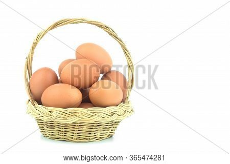 Eggs In The Basket Isolated On White Background With Copy Space For Writing Text And