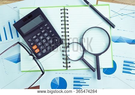 Top View Of The Businessman's Work, Calculator Placed On The Table.