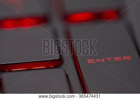 Closeup Of Enter Key Or Red Enter Button