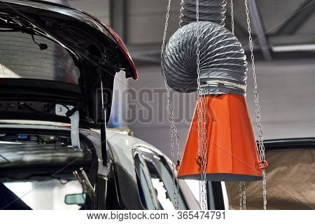 Hood Of An Industrial Air Extractor In Auto Repair Shop