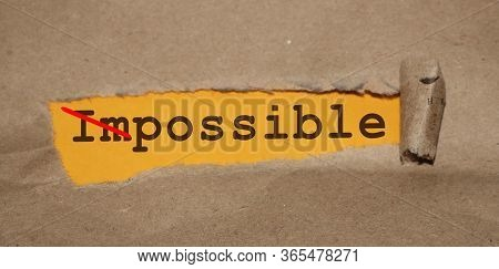 Torn Paper With Impossible Word Turned To Possible By Crossing Im. Business Concept