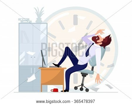 Businessman Sitting Leaning Back In Office Chair With His Foot On Computer Desk And Covering His Eye