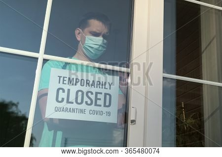 Temporarily Closed Sign On A Frontdoor, Close Up. Temporary Business Closure. Restaurant Closed Due