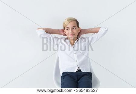 Solitude, Loneliness And Boredom Concept - Bored Teen Student Sitting In A School Chair Isolated On