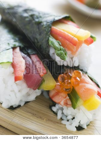 Three hand Rolled Seafood and Vegetable Sushi poster