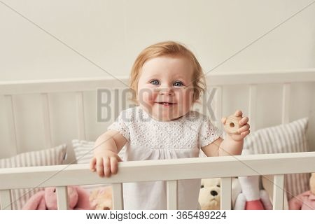 Children's Day. Sweet Funny Baby In Children Room. Scandi Style Girl Room. Child Play With Education