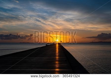 A Beautiful Sunset On The Island Of Koh Samui In Thailand, People On The Bridge During Sunset, A Par