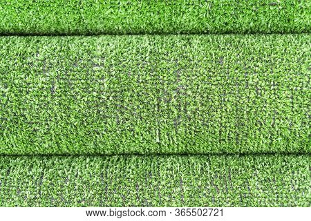 Artificial Grass Lawn Texture. Artificial Turf Background. Greenering With An Artificial Grass. Roll